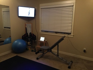 Here's where the magic happens. Note the gym mat, TV, iPad, weights, and weight bench.